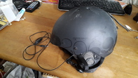 Helm mit Kopfhörer